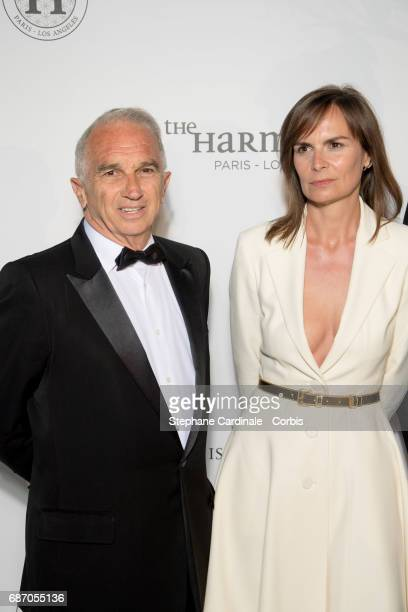 Alain Terzian and Brune de Margerie attend The Harmonist Party during the 70th annual Cannes Film Festival at on May 22 2017 in Cannes France