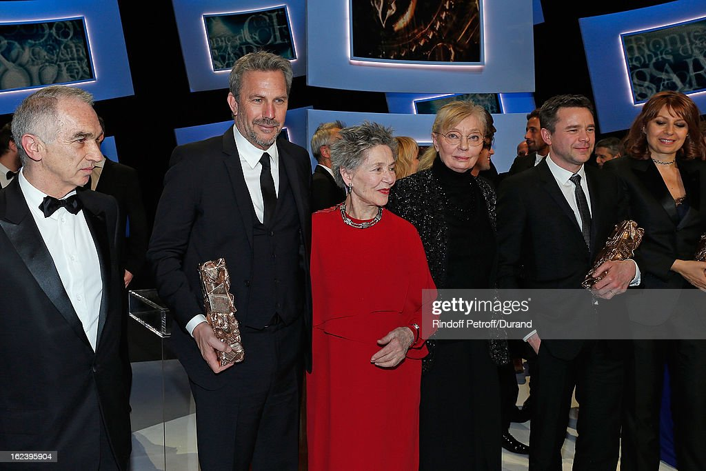 Alain terzian, President of the Cesar Awards Academy, <a gi-track='captionPersonalityLinkClicked' href=/galleries/search?phrase=Kevin+Costner&family=editorial&specificpeople=201719 ng-click='$event.stopPropagation()'>Kevin Costner</a>, holding his Cesar of Honor award, best actress <a gi-track='captionPersonalityLinkClicked' href=/galleries/search?phrase=Emmanuelle+Riva&family=editorial&specificpeople=2029319 ng-click='$event.stopPropagation()'>Emmanuelle Riva</a> for 'Amour', producer Margaret Menegoz, Guillaume de Tonquedec, best supporting actor for 'Le Prenom', and <a gi-track='captionPersonalityLinkClicked' href=/galleries/search?phrase=Valerie+Benguigui&family=editorial&specificpeople=4480204 ng-click='$event.stopPropagation()'>Valerie Benguigui</a>, best supporting actress for 'Le Prenom', pose at the end of the Cesar Film Awards 2013 at Theatre du Chatelet on February 22, 2013 in Paris, France.