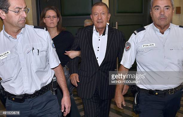 Alain Thurin former nurse of French L'Oreal heiress leaves the courthouse in Bordeaux western France flanked by police officers on October 6 after...