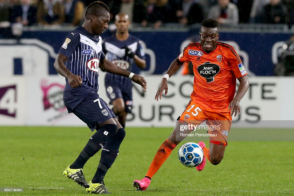 <a gi-track='captionPersonalityLinkClicked' href=/galleries/search?phrase=Alain+Traore&family=editorial&specificpeople=4146262 ng-click='$event.stopPropagation()'>Alain Traore</a> for Lorient (R) and Cedric Yambere (L) for Bordeaux in action during the French League Cup quarter final between Bordeaux and Lorient at Stade Matmut Atlantique on January 12, 2016 in Bordeaux, France.