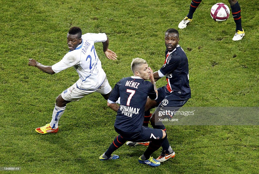 <a gi-track='captionPersonalityLinkClicked' href=/galleries/search?phrase=Alain+Traore&family=editorial&specificpeople=4146262 ng-click='$event.stopPropagation()'>Alain Traore</a> (L) of Auxerre competes with <a gi-track='captionPersonalityLinkClicked' href=/galleries/search?phrase=Jeremy+Menez&family=editorial&specificpeople=648636 ng-click='$event.stopPropagation()'>Jeremy Menez</a> (C) and <a gi-track='captionPersonalityLinkClicked' href=/galleries/search?phrase=Siaka+Tiene&family=editorial&specificpeople=788647 ng-click='$event.stopPropagation()'>Siaka Tiene</a> of Paris Saint Germain during the French Ligue 1 match between Paris Saint Germain and Auxerre at Parc des Princes on December 4, 2011 in Paris, France.