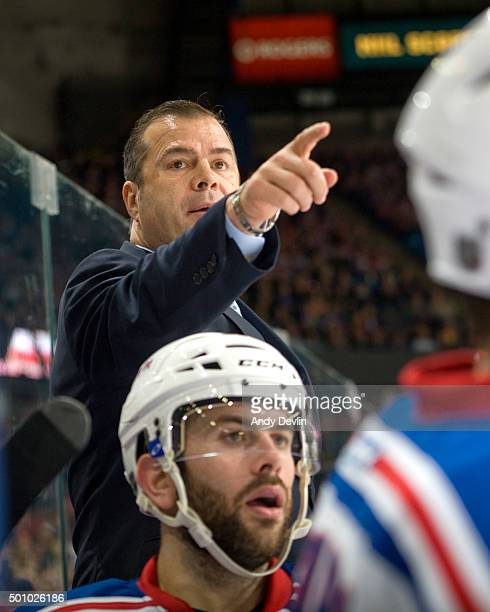 Alain Vigneault head coach of the New York Rangers behind the bench during his 1000th career NHL game during a game against the Edmonton Oilers on...