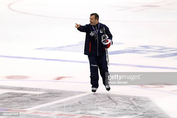 Alain Vigneault head coach of the New York Rangers looks on during a practice session ahead of the 2014 NHL Stanley Cup Final at Staples Center on...