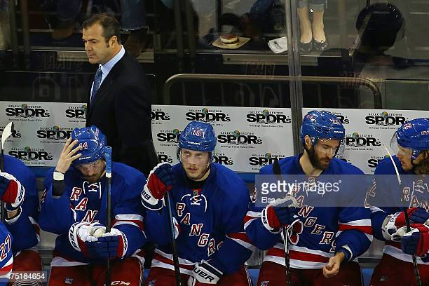Alain Vigneault of the New York Rangers looks on against the Tampa Bay Lightning during the second period in Game Seven of the Eastern Conference...