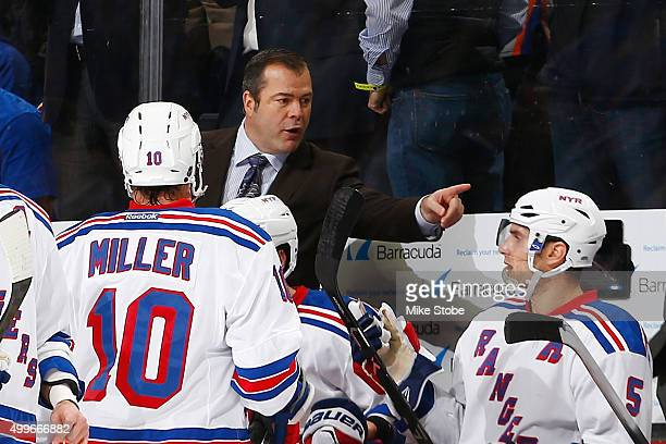 Alain Vigneault of the New York Rangers talks to Dan Girardi during the game against the New York Islanders at the Barclays Center on December 2 2015...