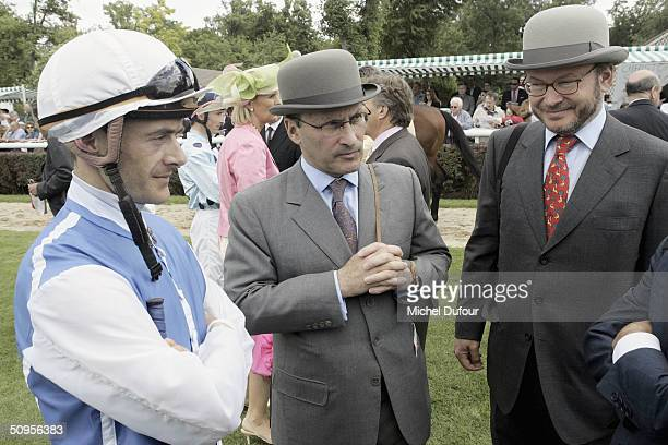 Alain Wertheimer and Gerard Wertheimer owners of the House of Chanel with jockey Olivier Peslier attend the Prix de Diane Hermes on June 13 2004 in...