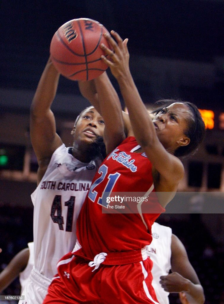 Alaina Coates (41) of the South Carolina Gamecocks grapples for a rebound with Kanedria Andrews (21) of the Louisiana Tech Lady Techsters during the first half at Colonial Life Arena in Columbia, S.C., on Sunday, Nov. 10, 2013.