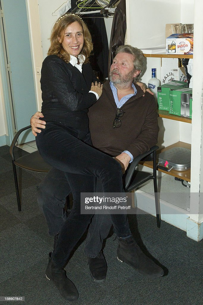 Alain-Dominique Perrin and his wife Florence pose in French impersonator Laurent Gerra's dressing room following his one man show at Olympia hall on December 26, 2012 in Paris, France.