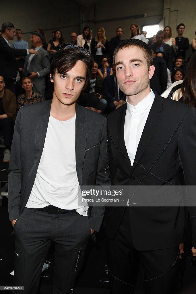 Alain-Fabien Delon and Robert Pattinson attend the Dior Homme Menswear Spring/Summer 2017 show as part of Paris Fashion Week on June 25, 2016 in Paris, France.