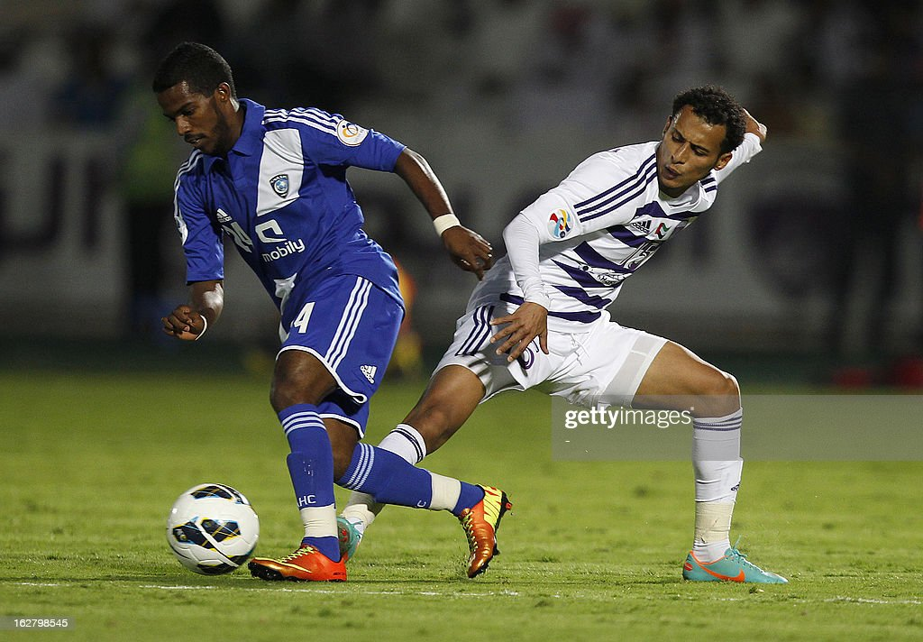 Al-Ain's Khaled Abdulrahman (R) vies for the ball against Al-Hilal 's Abdullah Al-Zori (L) during their AFC Champions League group D football match at the Sheikh Tahnoun Bin Mohammed Stadium in Al Ain, February 27, 2013. Al-Ain defeated Al-Hilal 3-1. AFP PHOTO/STR