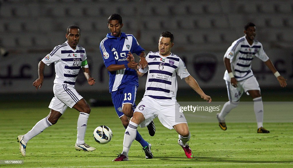 Al-Ain's Mirel Radoi (R) vies for the ball against Al-Hilal 's Salam Al-Faraj (C) during their AFC Champions League group D football match at the Sheikh Tahnoun Bin Mohammed Stadium in Al Ain, February 27, 2013. Al-Ain defeated Al-Hilal 3-1. AFP PHOTO/STR