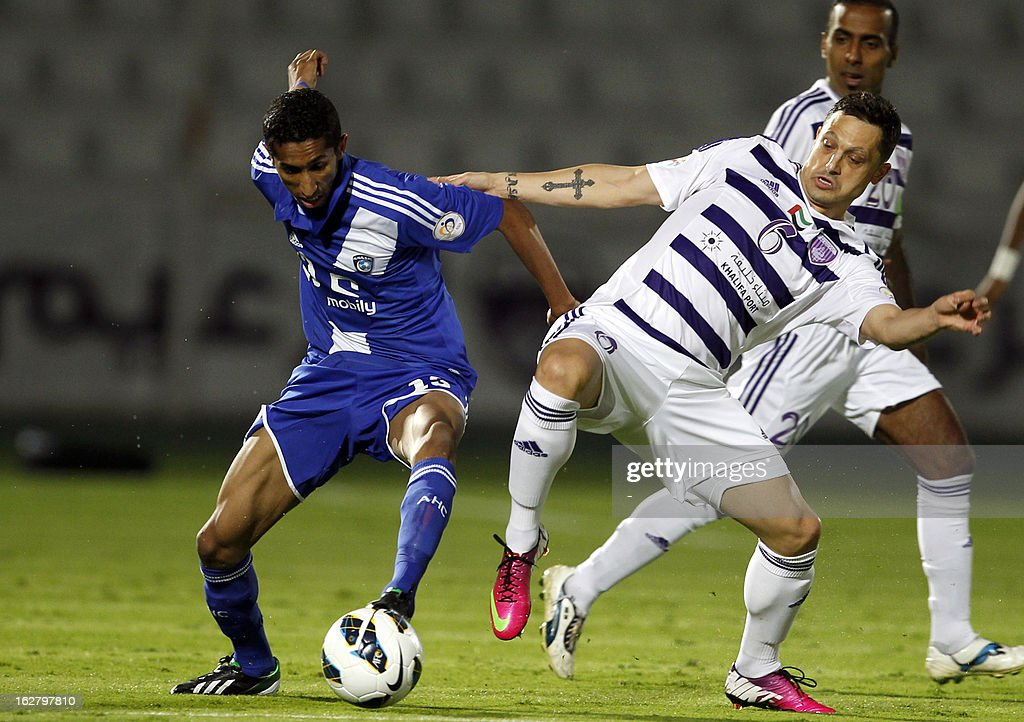 Al-Ain's Mirel Radoi (R) vies for the ball against Al-Hilal 's Salman al-Faraj (L) during their AFC Champions League group D football match at the Sheikh Tahnoun Bin Mohammed Stadium in Al Ain, February 27, 2013. Al-Ain defeated Al-Hilal 3-1. AFP PHOTO/STR