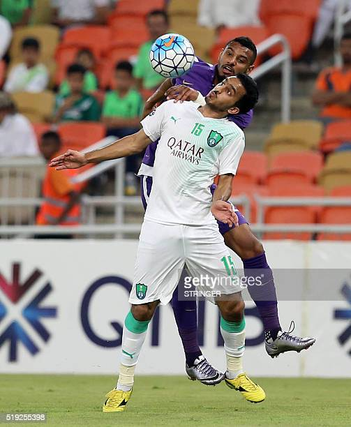 AlAin's Mohamed Gharib fights for the header with AlAhli's Saleh AlAjman during their AFC Champions League football match at King Abdullah Sports...