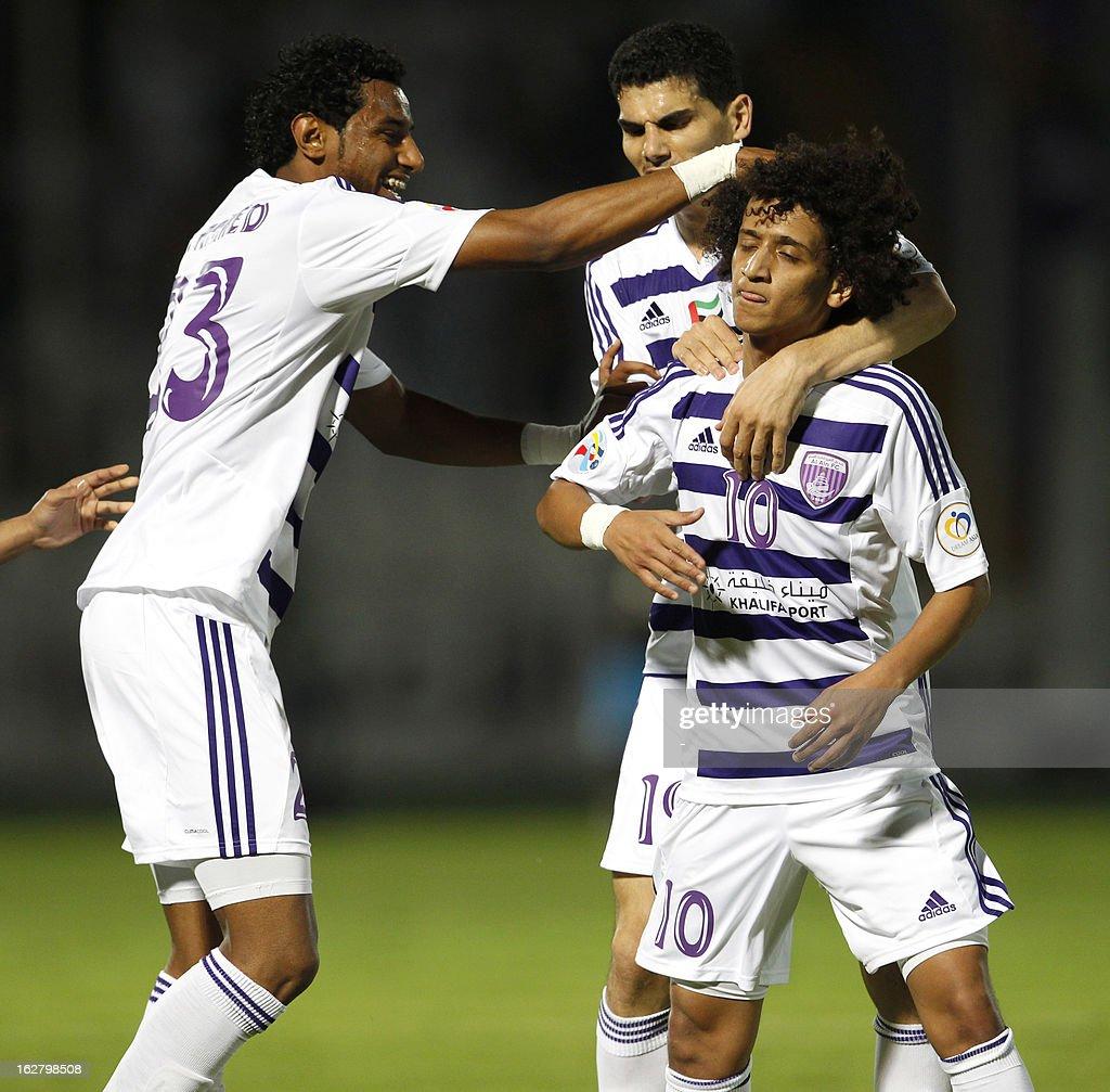 Al-Ain's Omar Abdulrahman (C) is congratulated by his team mates after scoring the team's first goal against Al-Hilal during their AFC Champions League group D football match at the Sheikh Tahnoun Bin Mohammed Stadium in Al Ain, February 27, 2013. Al-Ain defeated Al-Hilal 3-1.