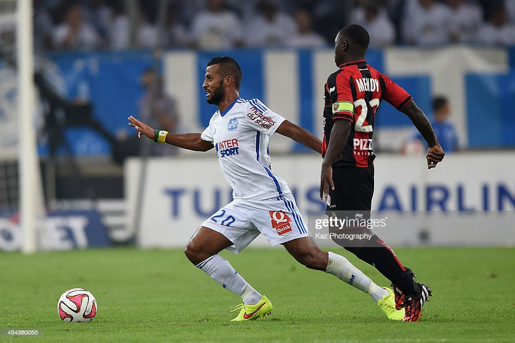 Alaixis Romao of Marseille and Nampalys Mendy of Nice compete for the ball during the French Ligue 1 match between Olympique de Marseille and OGC Nice at Stade Velodrome on August 29, 2014 in Marseille, France.