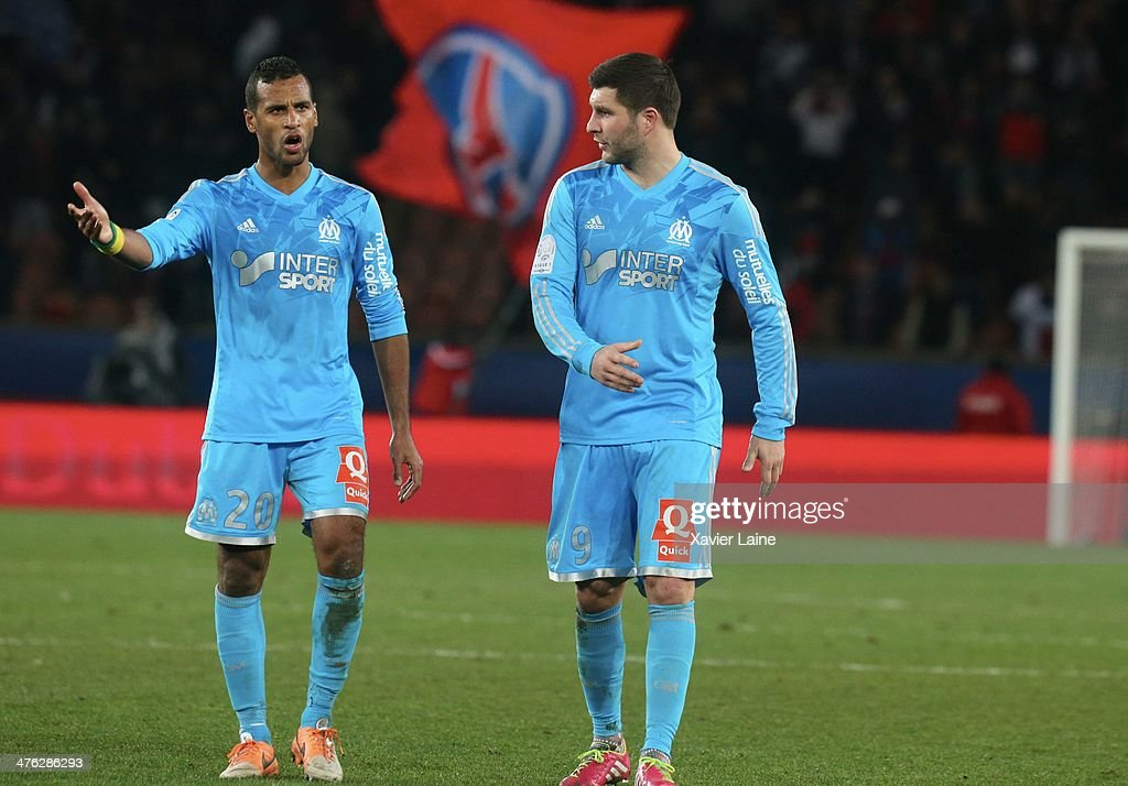 Alaixys Romao and Andre-Pierre Gignac of Olympique de Marseille react after defeat during the French Ligue 1 between Paris Saint-Germain FC and Olympique de Marseille at Parc Des Princes on March 2, 2014 in Paris, France.