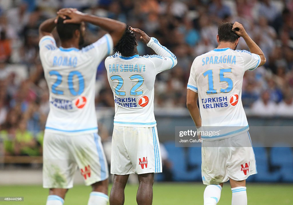 Alaixys Romao, Michy Batshuayi, Stephane Sparagna of OM react after missing a goal during the French Ligue 1 match between Olympique de Marseille (OM) and SM Caen at Stade Velodrome on August 8, 2015 in Marseille, France.