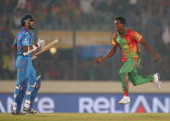 AlAmin Hossain of Bangladesh celebrates after dismissing Shikhar Dhawan of India during the ICC World Twenty20 Bangladesh 2014 match between...