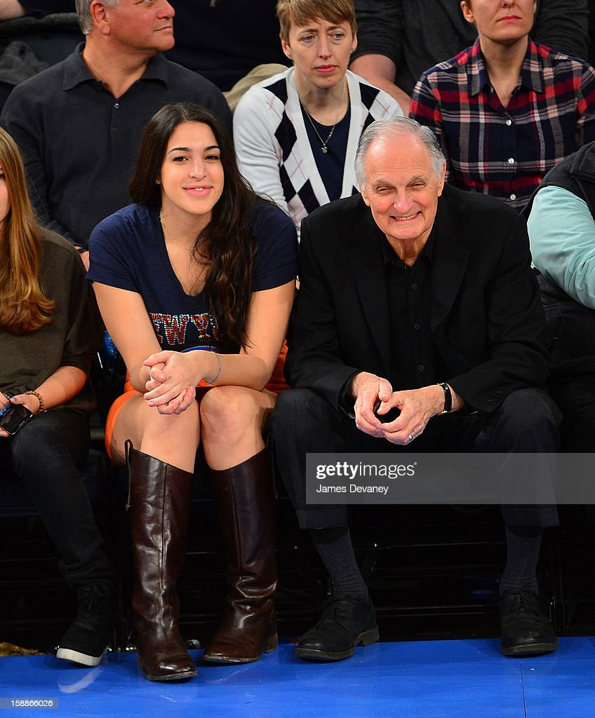 Alan Alda and guest attend the Portland Trail Blazers vs New York Knicks game at Madison Square Garden on January 1 2013 in New York City