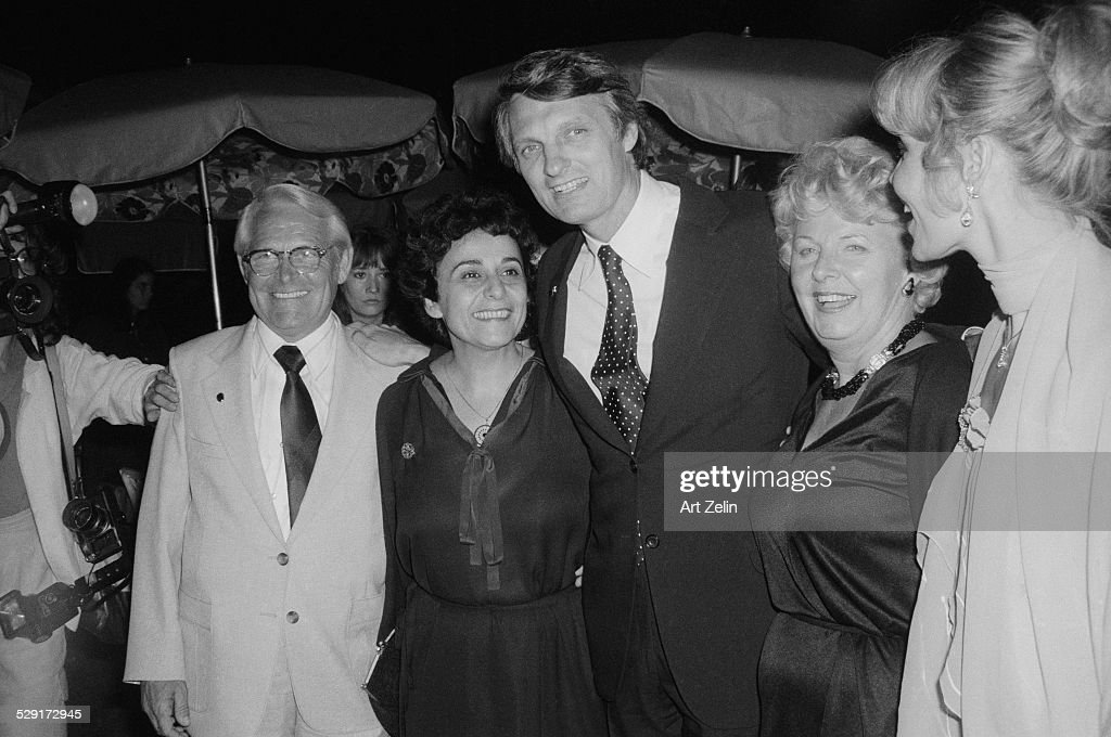 Alan Alda with his wife Arlene with dark hair and friends at an outdoor event circa 1970 New York