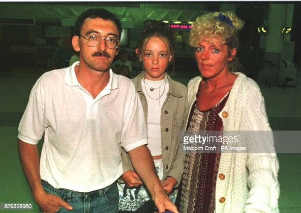 Alan and Margret Conway from Wigan with their daughter Catherine at Manchester Airport last night after arriving back from Reus Tarragona Spain where...