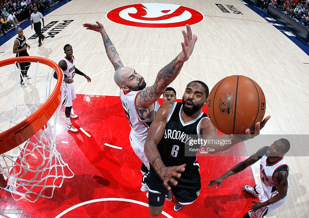 <a gi-track='captionPersonalityLinkClicked' href=/galleries/search?phrase=Alan+Anderson&family=editorial&specificpeople=3945355 ng-click='$event.stopPropagation()'>Alan Anderson</a> #6 of the Brooklyn Nets drives against Pero Antic #6 and <a gi-track='captionPersonalityLinkClicked' href=/galleries/search?phrase=Paul+Millsap&family=editorial&specificpeople=880017 ng-click='$event.stopPropagation()'>Paul Millsap</a> #4 of the Atlanta Hawks during Game Five of the Eastern Conference Quarterfinals of the NBA Playoffs at Philips Arena on April 29, 2015 in Atlanta, Georgia.