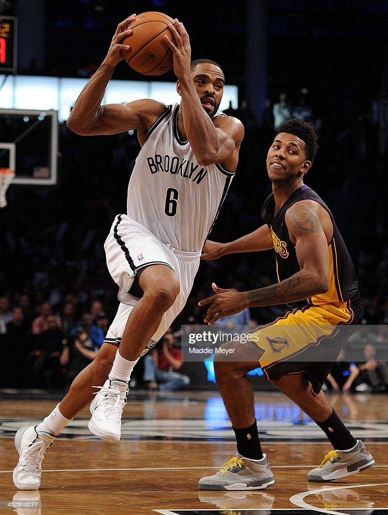 <a gi-track='captionPersonalityLinkClicked' href=/galleries/search?phrase=Alan+Anderson&family=editorial&specificpeople=3945355 ng-click='$event.stopPropagation()'>Alan Anderson</a> #6 of the Brooklyn Nets drives past Nick Young #0 of the Los Angeles Lakers during the second half at Barclays Center on November 27, 2013 in the Brooklyn borough of New York City. The Lakers defeat the Nets 99-94.