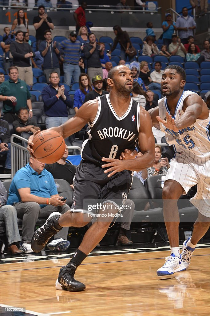 <a gi-track='captionPersonalityLinkClicked' href=/galleries/search?phrase=Alan+Anderson&family=editorial&specificpeople=3945355 ng-click='$event.stopPropagation()'>Alan Anderson</a> #6 of the Brooklyn Nets drives to the basket against <a gi-track='captionPersonalityLinkClicked' href=/galleries/search?phrase=E%27Twaun+Moore&family=editorial&specificpeople=4877476 ng-click='$event.stopPropagation()'>E'Twaun Moore</a> #55 of the Orlando Magic on November 3, 2013 at Amway Center in Orlando, Florida.