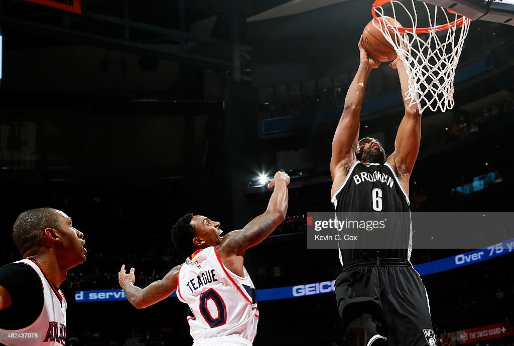<a gi-track='captionPersonalityLinkClicked' href=/galleries/search?phrase=Alan+Anderson&family=editorial&specificpeople=3945355 ng-click='$event.stopPropagation()'>Alan Anderson</a> #6 of the Brooklyn Nets dunks against <a gi-track='captionPersonalityLinkClicked' href=/galleries/search?phrase=Jeff+Teague&family=editorial&specificpeople=4680498 ng-click='$event.stopPropagation()'>Jeff Teague</a> #0 and <a gi-track='captionPersonalityLinkClicked' href=/galleries/search?phrase=Al+Horford&family=editorial&specificpeople=699030 ng-click='$event.stopPropagation()'>Al Horford</a> #15 of the Atlanta Hawks at Philips Arena on January 28, 2015 in Atlanta, Georgia.