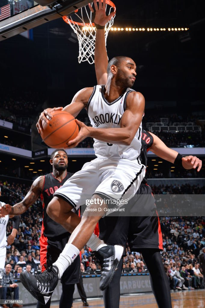 Alan Anderson #6 of the Brooklyn Nets looks to pass the ball in mid-air against the Toronto Raptors on March 10, 2014 at the Barclays Center in Brooklyn, New York.