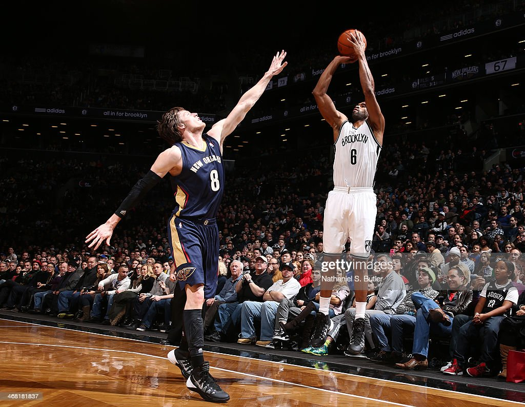 <a gi-track='captionPersonalityLinkClicked' href=/galleries/search?phrase=Alan+Anderson&family=editorial&specificpeople=3945355 ng-click='$event.stopPropagation()'>Alan Anderson</a> #6 of the Brooklyn Nets shoots against <a gi-track='captionPersonalityLinkClicked' href=/galleries/search?phrase=Luke+Babbitt&family=editorial&specificpeople=5122155 ng-click='$event.stopPropagation()'>Luke Babbitt</a> #8 of the New Orleans Pelicans during a game at the Barclays Center on February 9, 2014 in the Brooklyn borough of New York City.