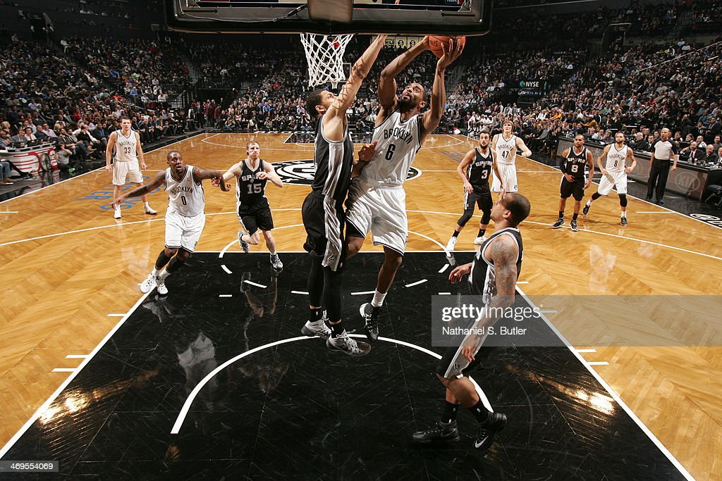 <a gi-track='captionPersonalityLinkClicked' href=/galleries/search?phrase=Alan+Anderson&family=editorial&specificpeople=3945355 ng-click='$event.stopPropagation()'>Alan Anderson</a> #6 of the Brooklyn Nets shoots against the San Antonio Spurs at the Barclays Center on February 06, 2014 in the Brooklyn borough of New York City.