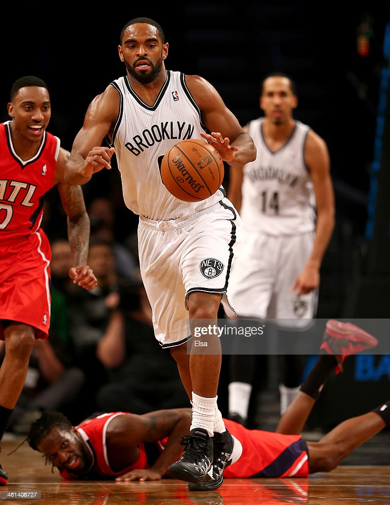 <a gi-track='captionPersonalityLinkClicked' href=/galleries/search?phrase=Alan+Anderson&family=editorial&specificpeople=3945355 ng-click='$event.stopPropagation()'>Alan Anderson</a> #6 of the Brooklyn Nets steals the ball from <a gi-track='captionPersonalityLinkClicked' href=/galleries/search?phrase=DeMarre+Carroll&family=editorial&specificpeople=784686 ng-click='$event.stopPropagation()'>DeMarre Carroll</a> #5 of the Atlanta Hawks at the Barclays Center on January 6, 2014 in the Brooklyn borough of New York City.The Brooklyn Nets defeated the Atlanta Hawks 91-86.