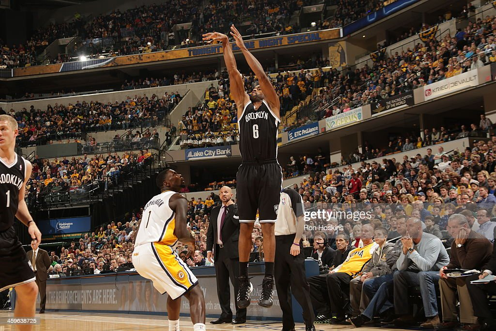 <a gi-track='captionPersonalityLinkClicked' href=/galleries/search?phrase=Alan+Anderson&family=editorial&specificpeople=3945355 ng-click='$event.stopPropagation()'>Alan Anderson</a> #6 of the Brooklyn Nets takes a shot against the Indiana Pacers at Bankers Life Fieldhouse on December 28, 2013 in Indianapolis, Indiana.