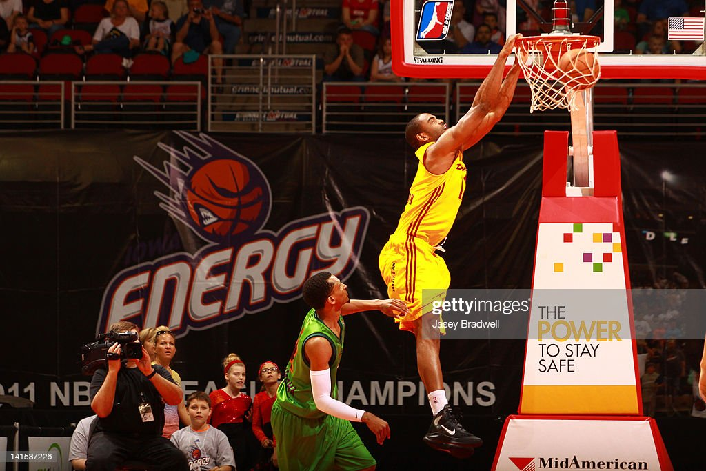 <a gi-track='captionPersonalityLinkClicked' href=/galleries/search?phrase=Alan+Anderson&family=editorial&specificpeople=3945355 ng-click='$event.stopPropagation()'>Alan Anderson</a> #11 of the Canton Charge slam dunks past Mike Efevberha #12 of the Iowa Energy in an NBA D-League game on March 16, 2012 at the Wells Fargo Arena in Des Moines, Iowa.