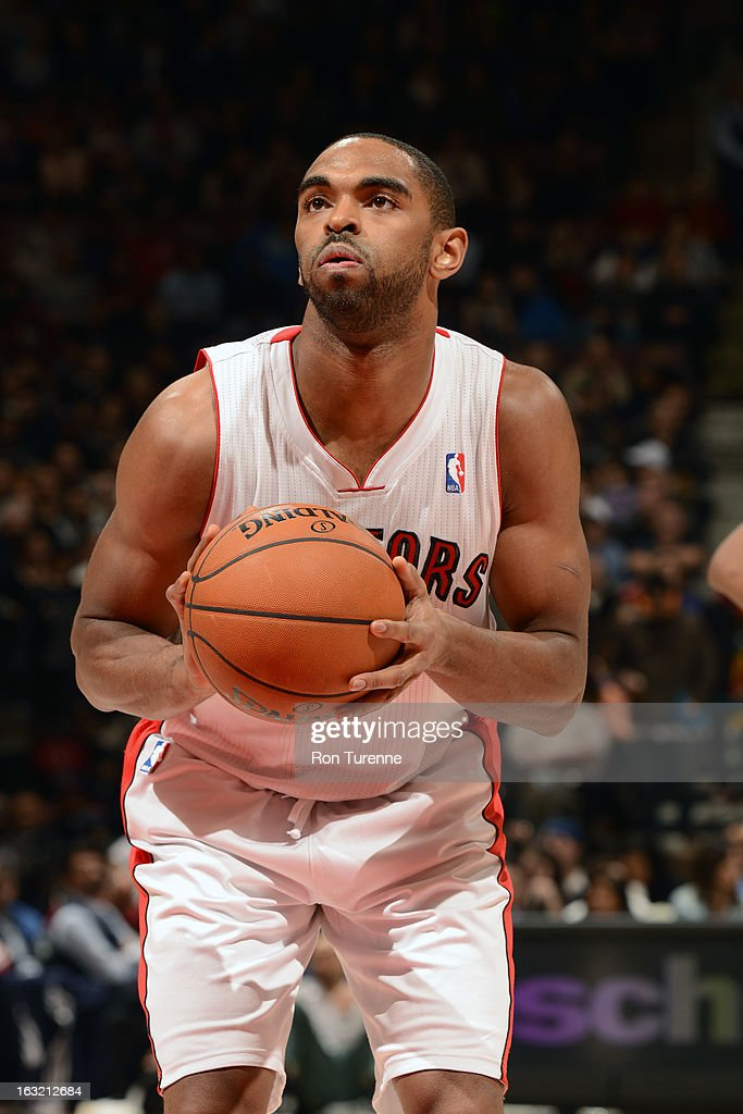<a gi-track='captionPersonalityLinkClicked' href=/galleries/search?phrase=Alan+Anderson&family=editorial&specificpeople=3945355 ng-click='$event.stopPropagation()'>Alan Anderson</a> #6 of the Toronto Raptors attempts a foul shot against the Washington Wizards on February 25, 2013 at the Air Canada Centre in Toronto, Ontario, Canada.