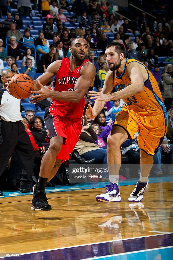 Alan Anderson #6 of the Toronto Raptors drives against Ryan Anderson #33 of the New Orleans Hornets on December 28, 2012 at the New Orleans Arena in New Orleans, Louisiana.