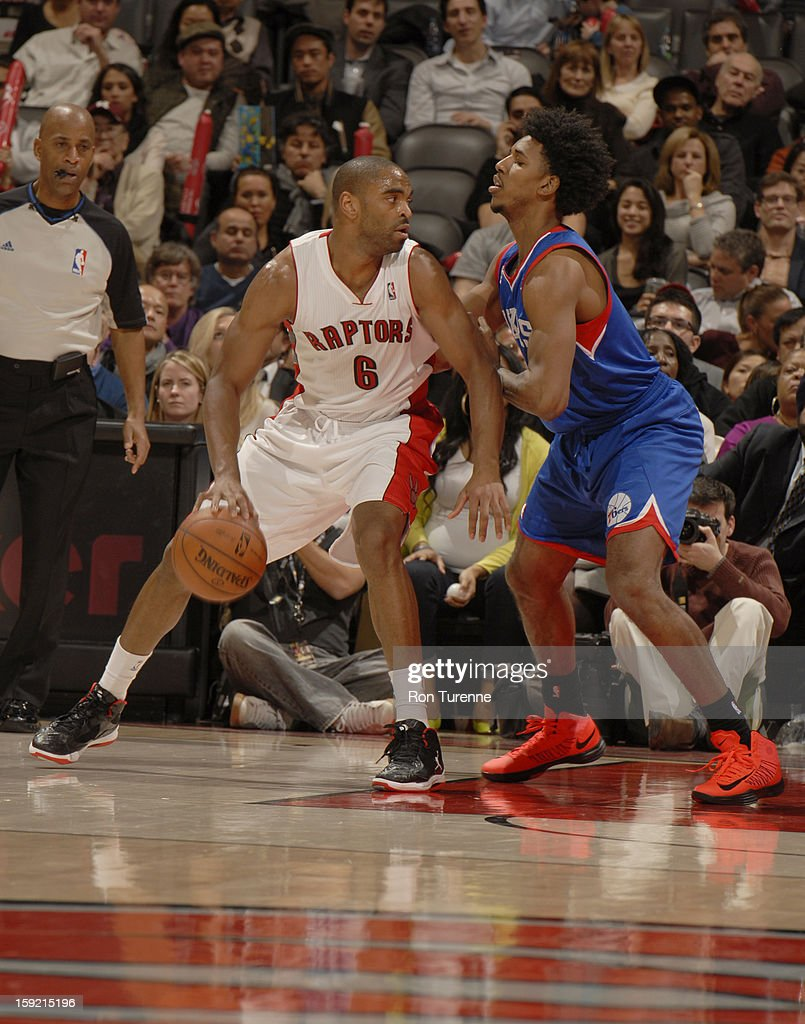 <a gi-track='captionPersonalityLinkClicked' href=/galleries/search?phrase=Alan+Anderson&family=editorial&specificpeople=3945355 ng-click='$event.stopPropagation()'>Alan Anderson</a> #6 of the Toronto Raptors drives to the basket against the Philadelphia 76ers during the game on January 9, 2013 at the Air Canada Centre in Toronto, Ontario, Canada.