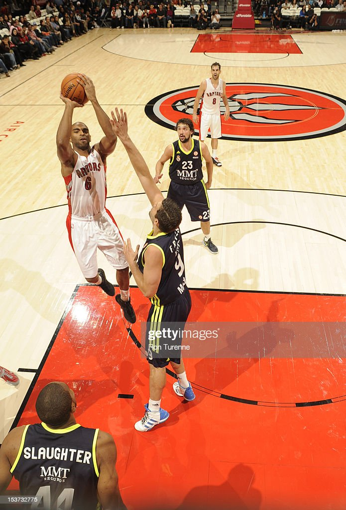 <a gi-track='captionPersonalityLinkClicked' href=/galleries/search?phrase=Alan+Anderson&family=editorial&specificpeople=3945355 ng-click='$event.stopPropagation()'>Alan Anderson</a> #6 of the Toronto Raptors goes to the basket against <a gi-track='captionPersonalityLinkClicked' href=/galleries/search?phrase=Felipe+Reyes&family=editorial&specificpeople=732755 ng-click='$event.stopPropagation()'>Felipe Reyes</a> #9 of the Real Madrid during the game between the Real Madrid and the Toronto Raptors on October 8, 2012 at the Air Canada Centre in Toronto, Canada.