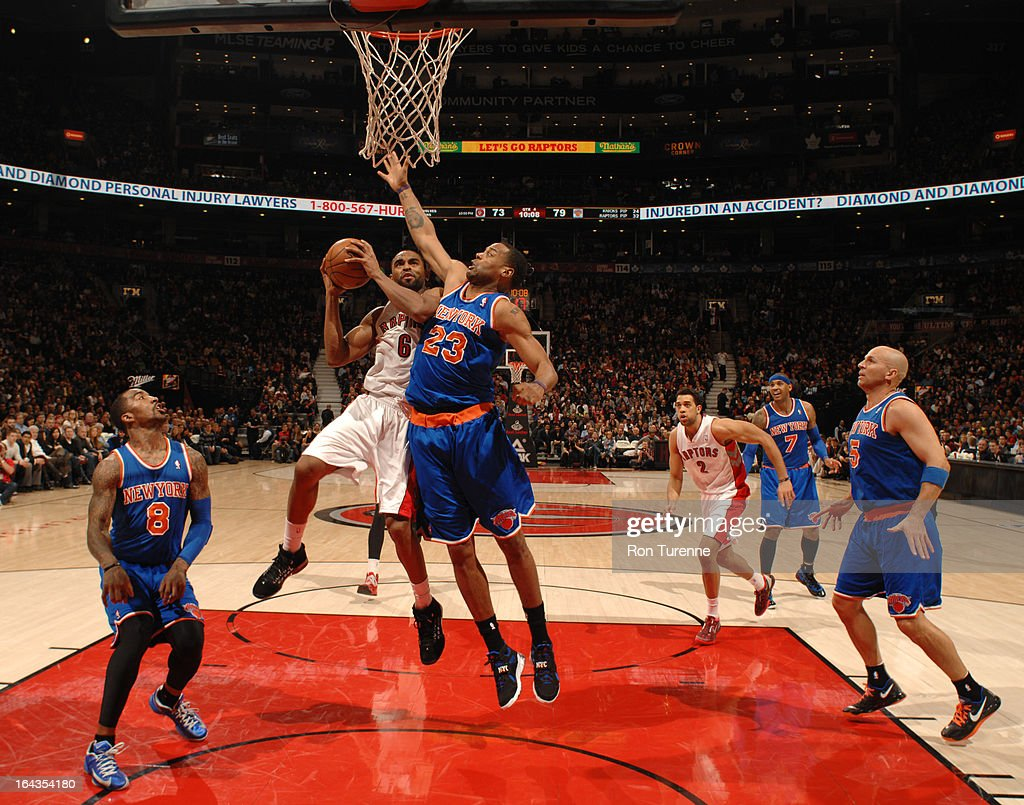 Alan Anderson #6 of the Toronto Raptors goes to the basket against Marcus Camby #23 of the New York Knicks on March 22, 2013 at the Air Canada Centre in Toronto, Ontario, Canada.