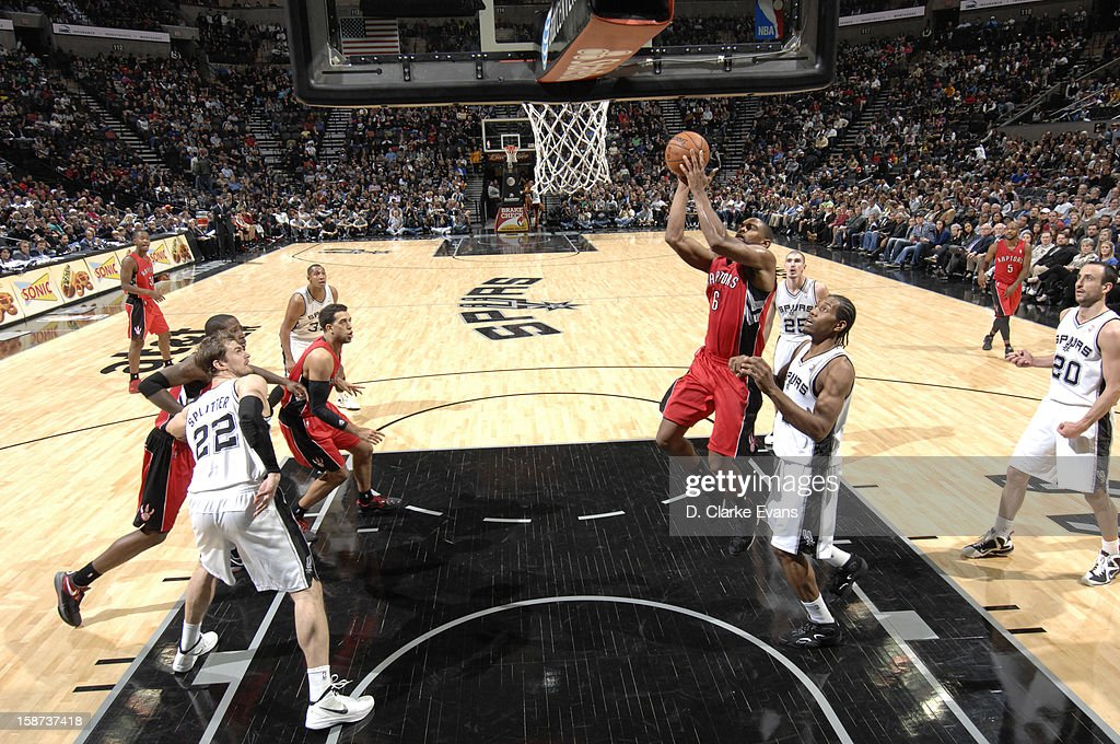 <a gi-track='captionPersonalityLinkClicked' href=/galleries/search?phrase=Alan+Anderson&family=editorial&specificpeople=3945355 ng-click='$event.stopPropagation()'>Alan Anderson</a> #6 of the Toronto Raptors goes to the basket during the game between the Toronto Raptors and the San Antonio Spurs on December 26, 2012 at the AT&T Center in San Antonio, Texas.