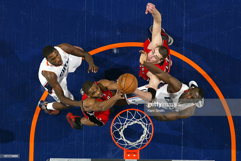<a gi-track='captionPersonalityLinkClicked' href=/galleries/search?phrase=Alan+Anderson&family=editorial&specificpeople=3945355 ng-click='$event.stopPropagation()'>Alan Anderson</a> #6 of the Toronto Raptors goes up for a rebound against the Charlotte Bobcats at the Time Warner Cable Arena on March 20, 2013 in Charlotte, North Carolina.