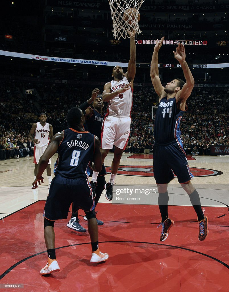 <a gi-track='captionPersonalityLinkClicked' href=/galleries/search?phrase=Alan+Anderson&family=editorial&specificpeople=3945355 ng-click='$event.stopPropagation()'>Alan Anderson</a> #6 of the Toronto Raptors goes up for a shot against Jeffery Taylor #44 of Charlotte Bobcats during the game on January 11, 2013 at the Air Canada Centre in Toronto, Ontario, Canada.