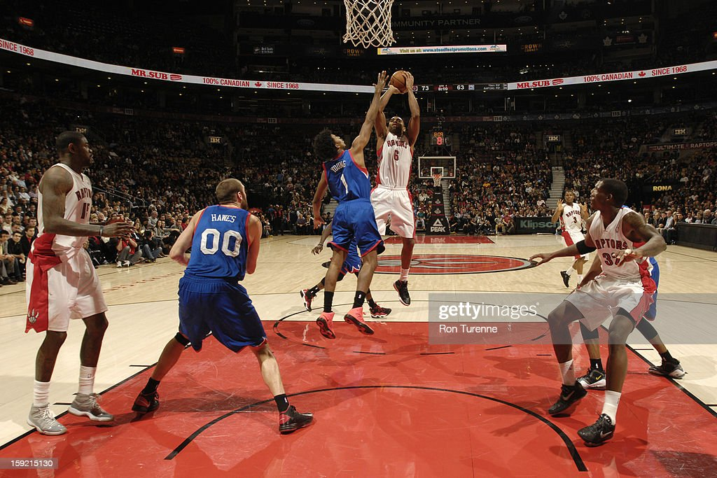 <a gi-track='captionPersonalityLinkClicked' href=/galleries/search?phrase=Alan+Anderson&family=editorial&specificpeople=3945355 ng-click='$event.stopPropagation()'>Alan Anderson</a> #6 of the Toronto Raptors goes up for the shot against Nick Young #1 of Philadelphia 76ers during the game on January 9, 2013 at the Air Canada Centre in Toronto, Ontario, Canada.
