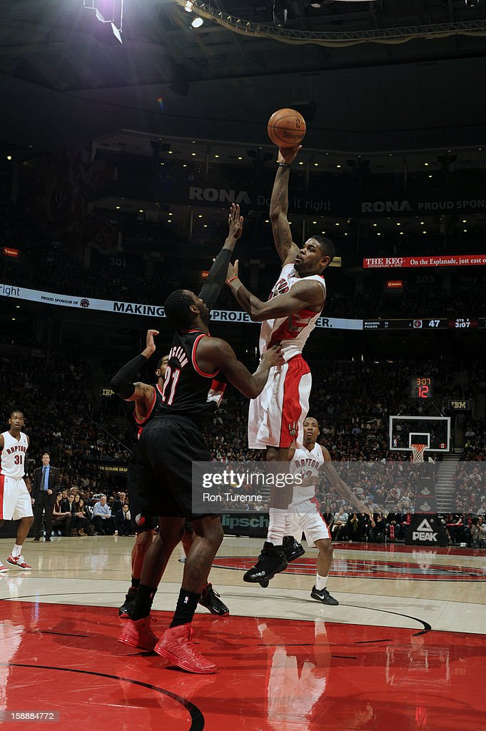 Alan Anderson #6 of the Toronto Raptors lets one fly against the Portland Trail Blazers during the game on January 2, 2013 at the Air Canada Centre in Toronto, Ontario, Canada.