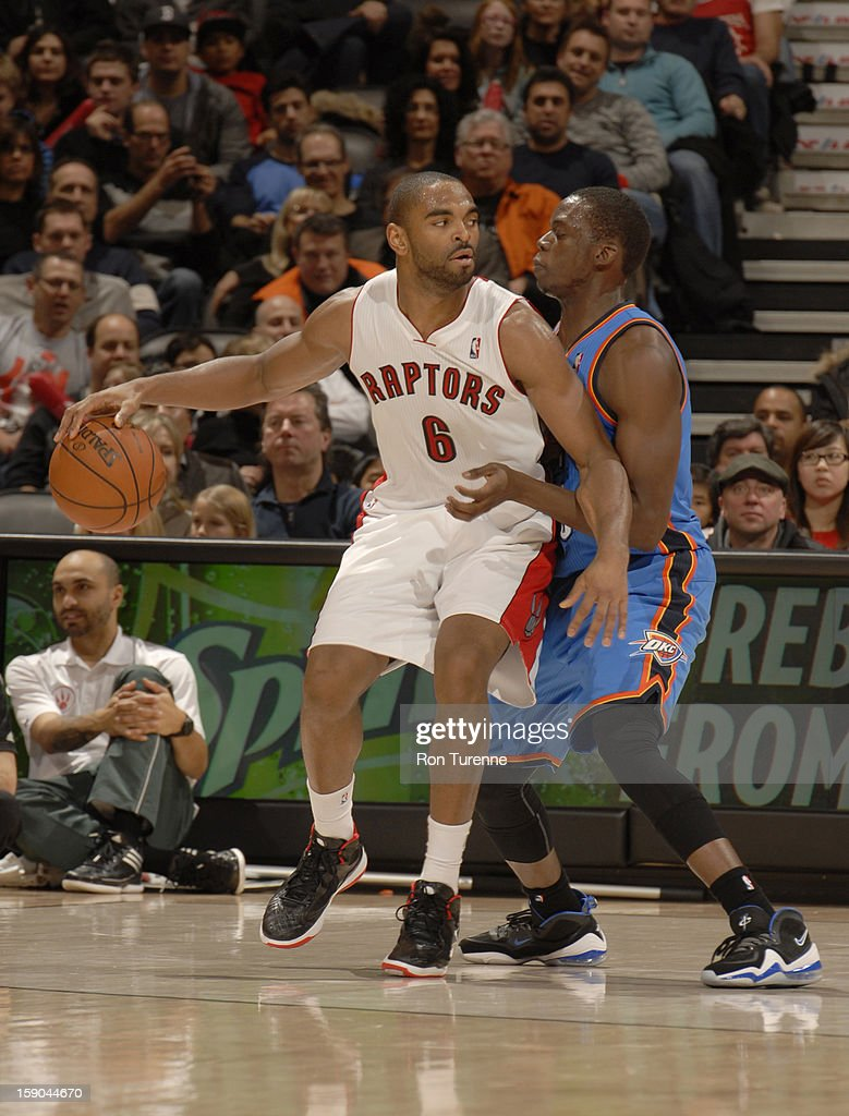<a gi-track='captionPersonalityLinkClicked' href=/galleries/search?phrase=Alan+Anderson&family=editorial&specificpeople=3945355 ng-click='$event.stopPropagation()'>Alan Anderson</a> #6 of the Toronto Raptors protects the ball during the game between the Toronto Raptors and the Oklahoma City Thunder on January 6, 2013 at the Air Canada Centre in Toronto, Ontario, Canada.