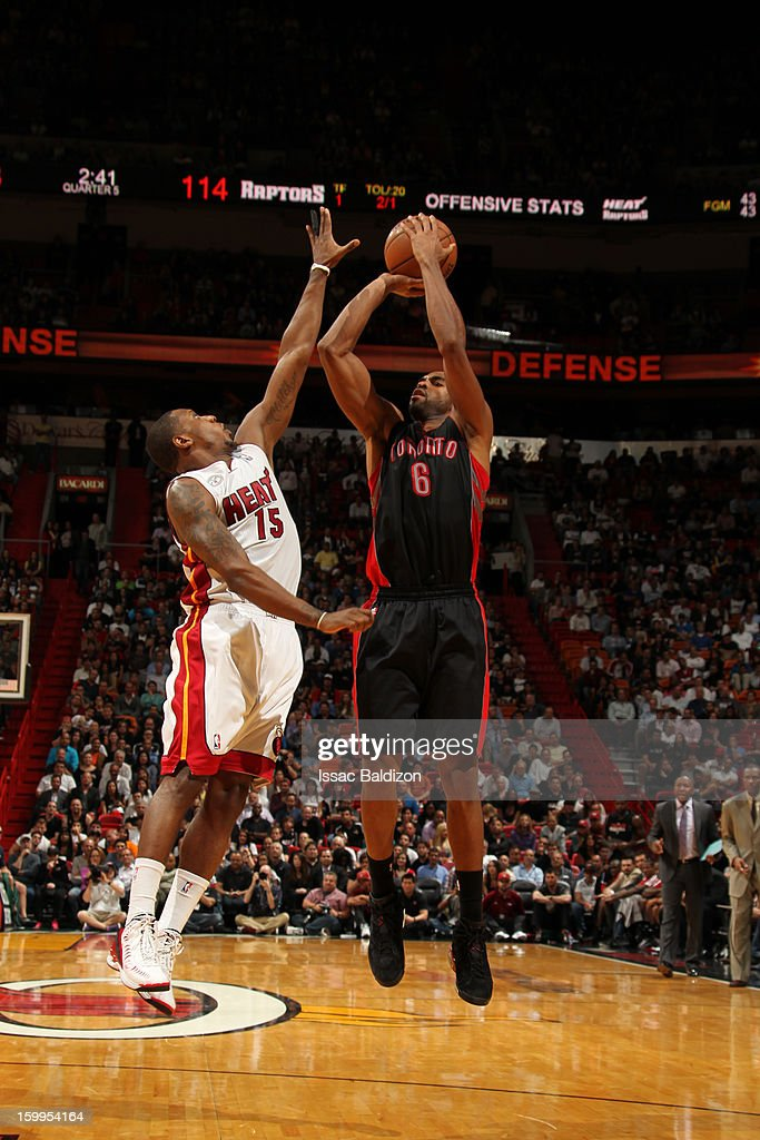 Alan Anderson #6 of the Toronto Raptors shoots a jumper against Mario Chalmers #15 of the Miami Heat on January 23, 2013 at American Airlines Arena in Miami, Florida.