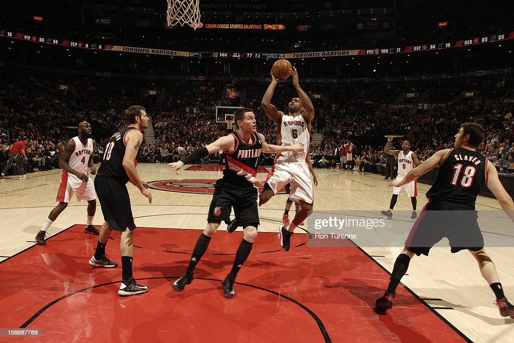 <a gi-track='captionPersonalityLinkClicked' href=/galleries/search?phrase=Alan+Anderson&family=editorial&specificpeople=3945355 ng-click='$event.stopPropagation()'>Alan Anderson</a> #6 of the Toronto Raptors shoots a short jump shot against the Portland Trail Blazers during the game on January 2, 2013 at the Air Canada Centre in Toronto, Ontario, Canada.