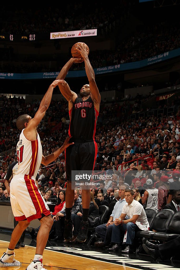 Alan Anderson #6 of the Toronto Raptors shoots a three pointer against Shane Battier #31 of the Miami Heat on January 23, 2013 at American Airlines Arena in Miami, Florida.