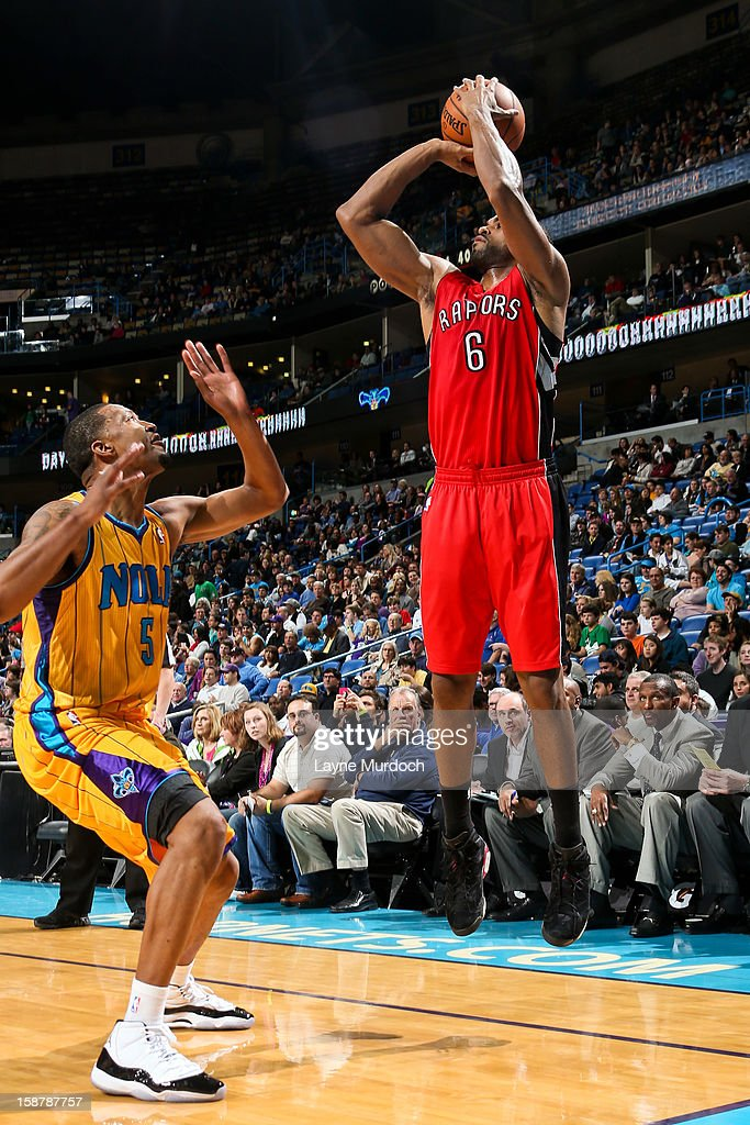 Alan Anderson of the Toronto Raptors shoots a threepointer against Dominic McGuire of the New Orleans Hornets on December 28 2012 at the New Orleans...